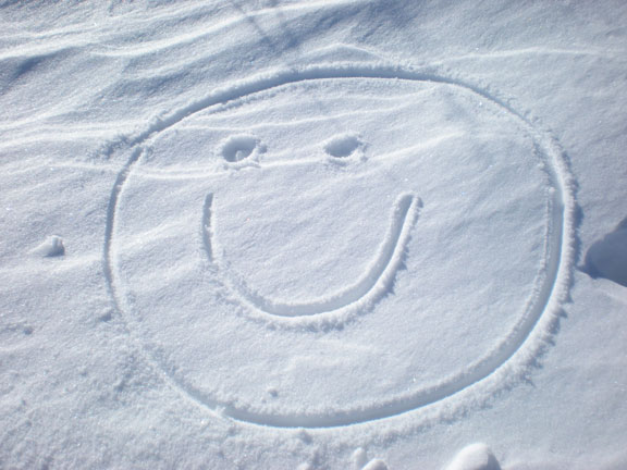 smile face drawn in the snow