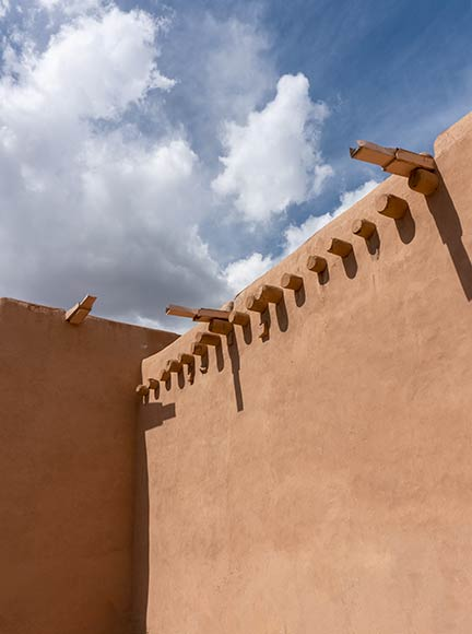 Adobe building with blue sky and clouds